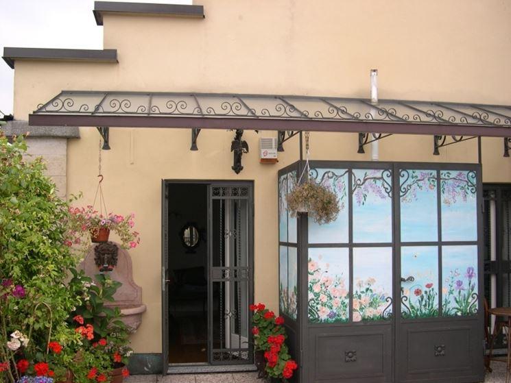 Pensiline in ferro battuto pergole e tettoie da giardino - Tettoie da giardino in ferro ...