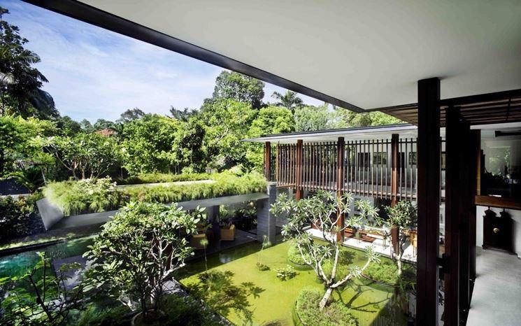 tetto da giardino in cemento e con pilastri in legno