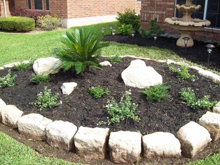 Good risultati immagini per giardini con aiuole e sassi for Sassi bianchi da giardino prezzo