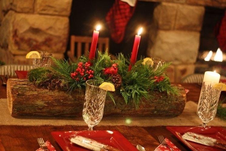 Centrotavola con candele realizzato da un fiorista