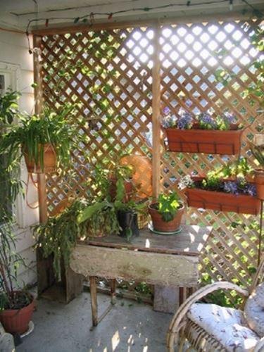Grigliati in legno per terrazzo grigliati e frangivento for Divisori da giardino