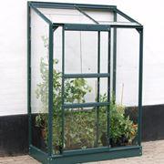 Una serra da balcone in acciaio e vetro