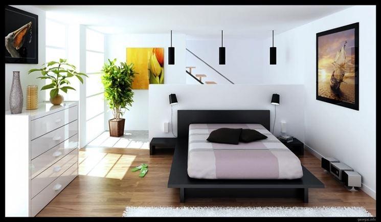 Camera da letto decorata con due piante finte da arredo